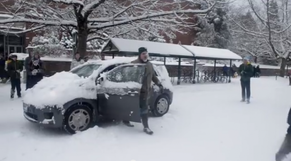 A retired professor is pelted with snow.