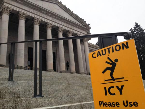 This sign at the steps to the Washington statehouse captures more than just the weather conditions.