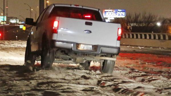 Cobblestone ice has made travel downright dangerous. Over the weekend, Ross Hailey of the Fort Worth <em>Star-Telegram</em> captured this truck driving over cobblestone ice in Haltom City.