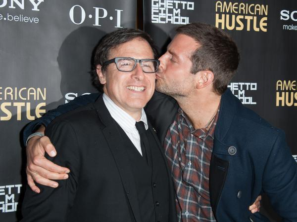 Russell (left) shares a moment with Bradley Cooper at an <em>American Hustle</em> screening. Russell also directed Cooper in last year's <em>Silver Linings Playbook</em>.