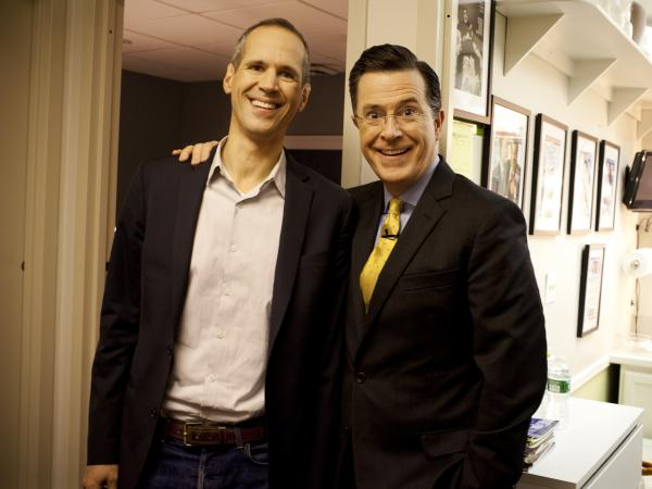 Planet Money's Alex Blumberg with Stephen Colbert at <em>The Colbert Report </em>on December 10, 2012.