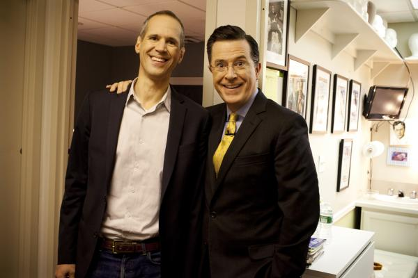 Planet Money's Alex Blumberg and Stephen Colbert after a taping of <em>The Colbert Report </em>on December 10, 2013.