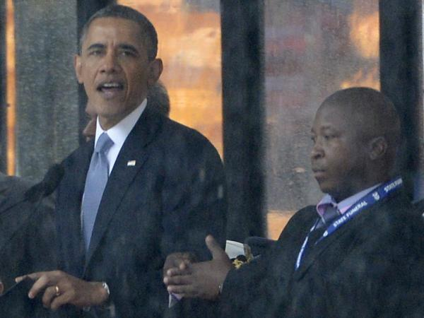 Thamsanqa Jantjie, 34, appeared alongside President Obama and other world leaders during Tuesday's memorial for Nelson Mandela in Johannesburg, South Africa. Many in the deaf community are outraged over Jantjie's sign language interpretation.