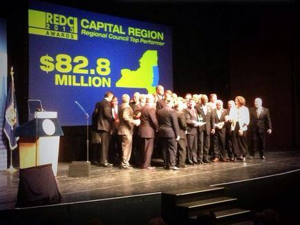 Each region was given a portion of $715 million in state money for economic development.