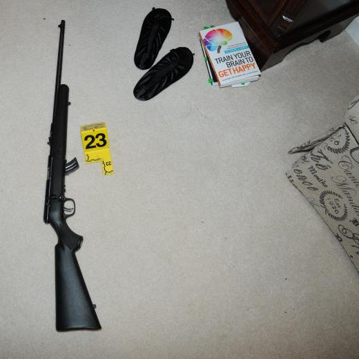 A crime scene photo provided by the Connecticut State Police shows a rifle in the master bedroom in Adam Lanza's house.