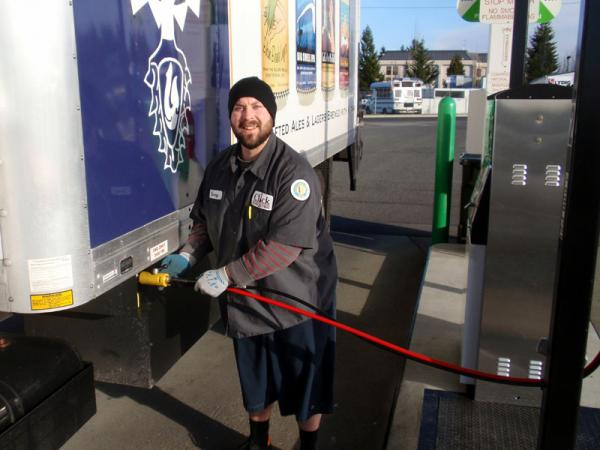 Driver Corey Schaller refuels his CNG-powered delivery truck.
