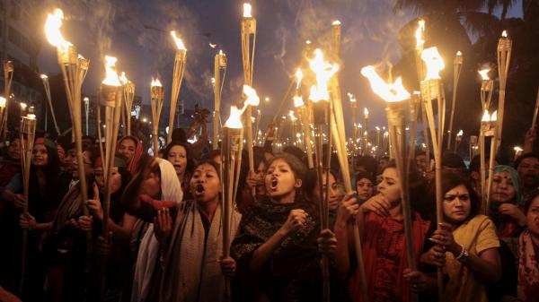 Bangladeshi activists participate in a rally Thursday in the capital, Dhaka, celebrating the Supreme Court's decision to clear the way for the execution of Jamaat-e-Islami leader Abdul Quader Mollah. Mollah was hanged Thursday for crimes committed during the country's 1971 war of independence.