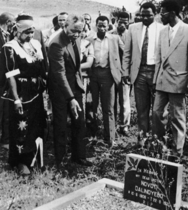 Mandela, who was then deputy president of the African National Congress, accompanied by his then-wife Winnie, visits his family grave in Qunu, on April 26, 1990.