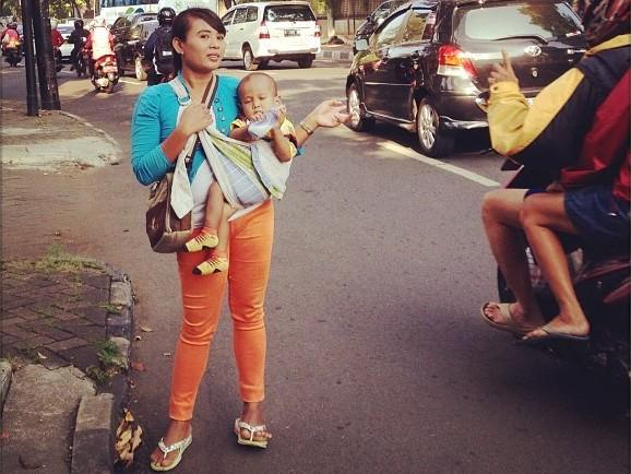 For a price, this Jakarta mother will get into your car so you can drive in the carpool lane.