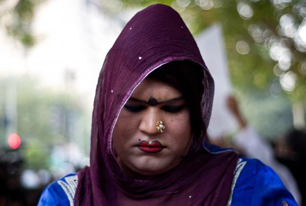 An Indian gay rights activist looks down during an anti-Section 377 protest in New Delhi on December 11, 2013.