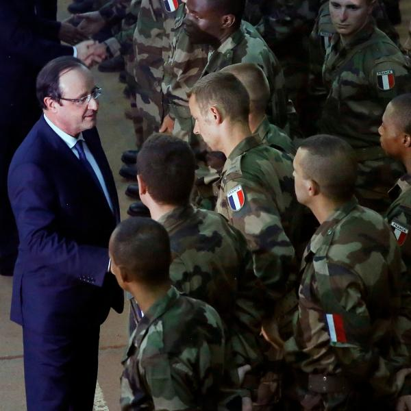 French President Francois Hollande talks to French troops in the Central African Republic on Tuesday.