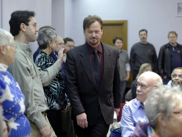 The Rev. Frank Schaefer, a United Methodist clergyman convicted of breaking church law for officiating at his son's same-sex wedding, enters a news conference at the Arch Street United Methodist Church in Philadelphia on Monday.