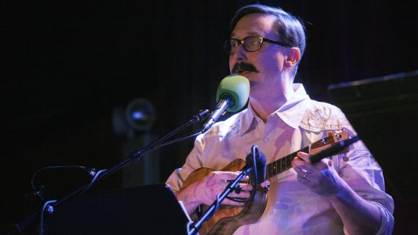 "Comedian John Hodgman helped lead a game, then picked up the ukulele for a rendition of ""Auld Lang Syne."""