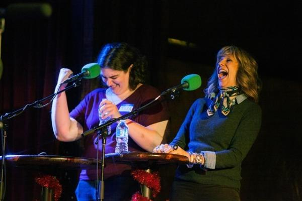 Holiday spirit, trivia, games, puzzles and comedy make for a potent mix for VIP Lizz Winstead and her opponent, Julia Lunetta. Just before this picture was taken, Lunetta re-enacted Tarzan's yell on stage. By all reports, it was an incredible rendition. Don't think you wouldn't LYAO too.