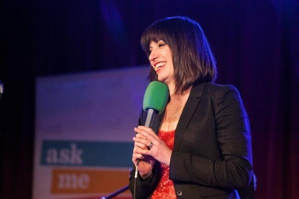 <em>Ask Me Another</em> Host Ophira Eisenberg enjoys a jolly moment on stage.