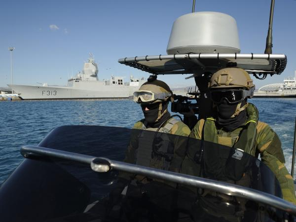 Norwegian marines patrol the waters around the Norwegian frigate HNOMS Helge Ingstad, which was docked in Cyprus over the weekend. The frigate, and the Danish warship HDMS Esbern Snare, will escort Danish and Norwegian cargo ships transporting Syria's most dangerous chemical weapons.