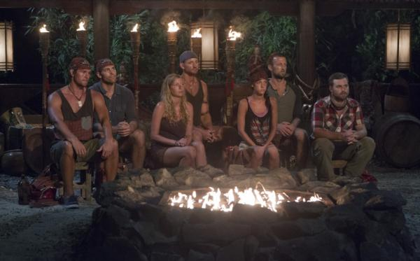 "The latest cast of ""Survivor"" anticipates someone being voted off the show. (CBS)"