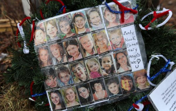 Photos of Sandy Hook Elementary School massacre victims sit at a small memorial near the school on January 14, 2013, in Newtown, Connecticut. (John Moore/Getty Images)