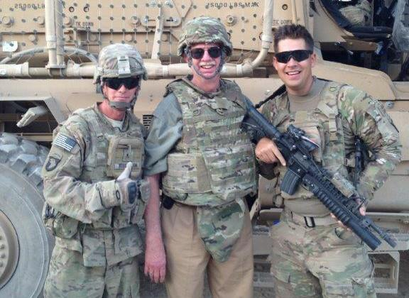 Jeff Traylor, a 71-year-old contractor in Afghanistan (center), flanked by two servicemen. (Jeff Traylor)