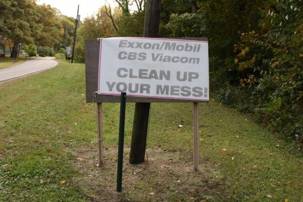 A sign shows frustration with the clean up process.