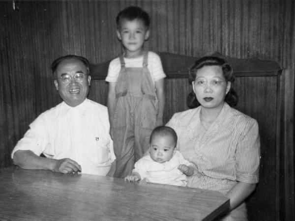 "William Wong (standing) poses with his parents and nephew in an old family photo. Wong's mother immigrated to the U.S. from China as his father's ""sister"" to bypass the Chinese Exclusion Act of 1882."