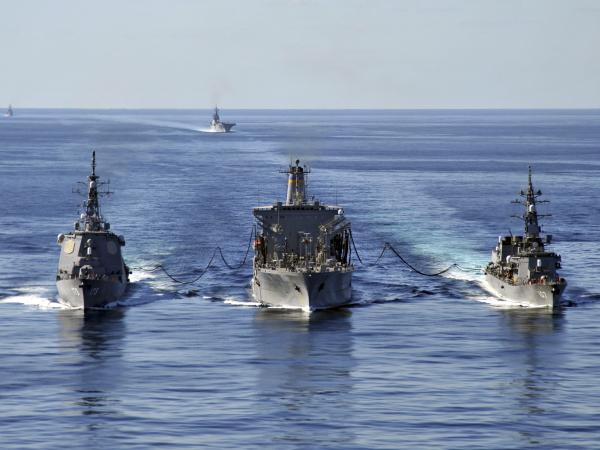 In this Dec. 5, 2010 file photo released by U.S. Navy, USNS Tippecanoe, center, refuels Japan Maritime Self-Defense Force Escort Flotilla ships Ikazuchi, right, and Kongo during a joint military exercise in the Pacific Ocean.