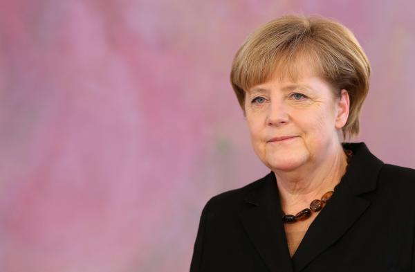 German Chancellor Angela Merkel attends a ceremony in which German President Joachim Gauck appointed the new German government cabinet on Tuesday in Berlin, Germany.