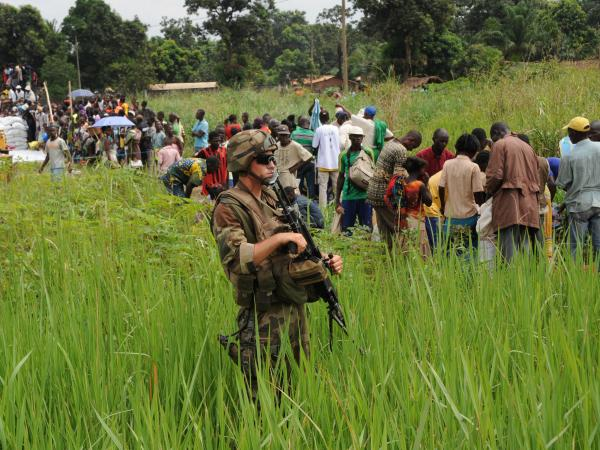French troops guard the distribution of food by the World Food Program to refugees near Bangui airport on Dec. 13.