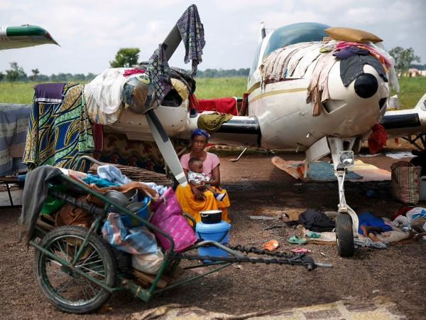 Christians gather in a makeshift camp for internally displaced people at the airport in Bangui on Dec. 13. More than 30,000 people have gathered there.