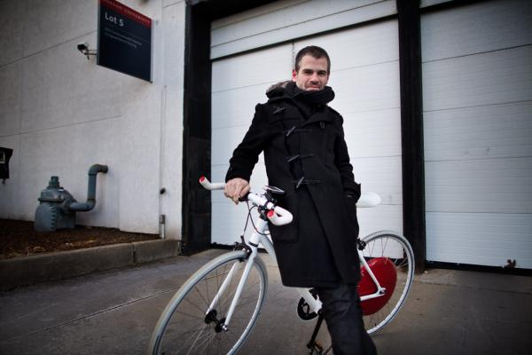 Copenhagen Wheel co-inventor Assaf Biderman outside the Here & Now studios. (Jesse Costa/Here & Now)