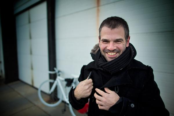 Assaf Biderman outside the Here & Now studios for a Copenhagen Wheel demo. (Jesse Costa/Here & Now)