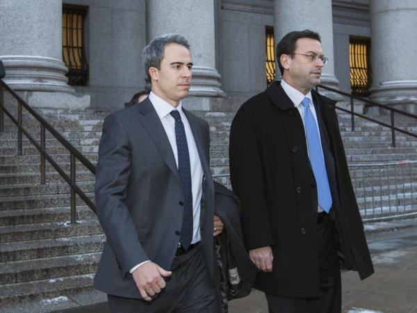 Michael Steinberg (left) departs federal court in Manhattan on Wednesday after being found guilty on charges that he traded on insider information.