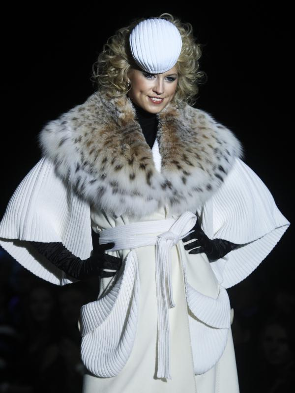 A model displays a creation by Russian designer Igor Gulyaev during the Volvo Fashion Week in Moscow on Oct. 27, 2011.