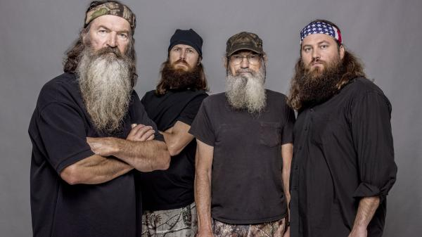 This 2012 photo released by A&E shows Phil Robertson (from left), Jase Robertson, Si Robertson and Willie Robertson from the A&E series <em>Duck Dynasty.</em>