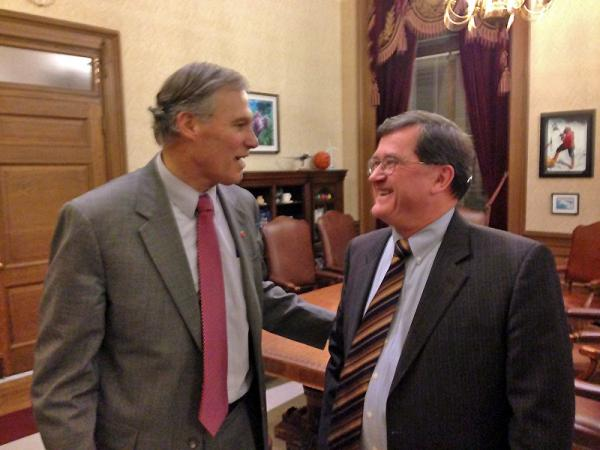 Governor Jay Inslee has a light moment with transportation co-chair Senator Curtis King, R-Yakima after announcing there is no deal on a gas tax package.