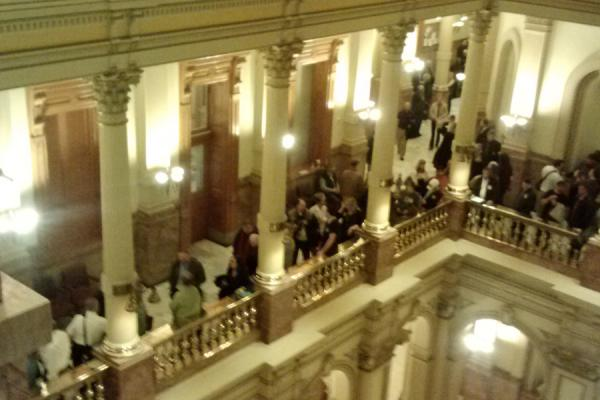 A sign of the intense debate, gun advocates wait outside the capitol's largest hearing room because the room is full, March 4, 2013.
