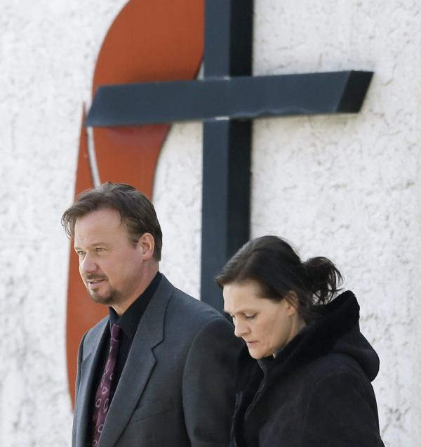 Accompanied by his wife Brigitte, right, Rev. Frank Schaefer of Lebanon, Pa., departs Thursday after meeting with officials at the Eastern Pennsylvania Conference of the United Methodist Church in Norristown, Pa.