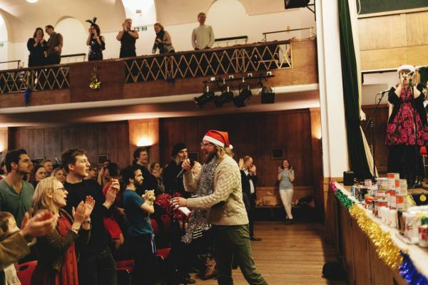 "Sanderson Jones, co-founder of Sunday Assembly, at a ""Mythmas"" celebration in London. (Jack Davolio)"