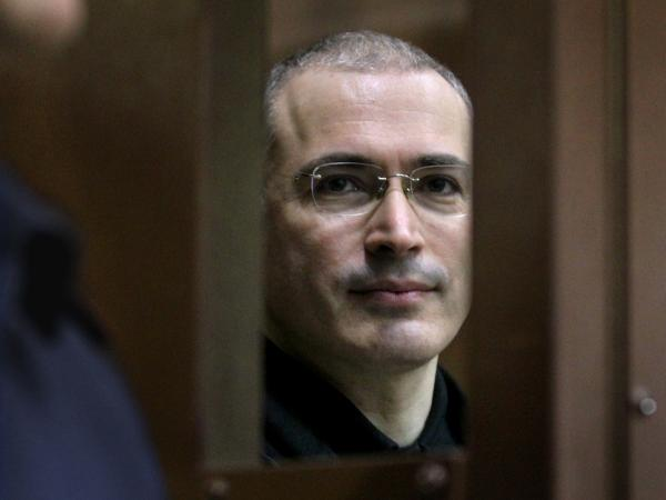 Former Yukos oil company CEO Mikhail Khodorkovsky looks through the defendant's glass cage in a Moscow courtroom on Nov. 1, 2010.