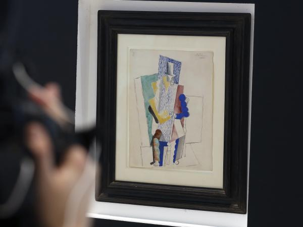 Picasso's 1914 cubist drawing <em>L'homme au Gibus,</em> or <em>Man in the Opera Hat,</em> is presented at Sotheby's auction house in Paris.