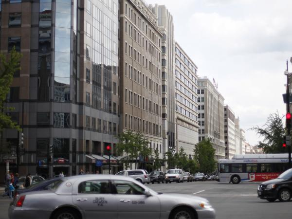 Office buildings with uniform heights are seen on 13th Street NW in downtown Washington.  A 1910 law limits their heights.