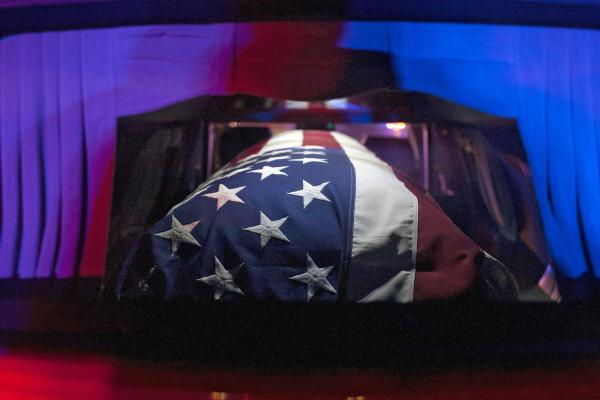 The casket of U.S. Army Sgt. Joseph Gantt rests inside a hearse on Friday.