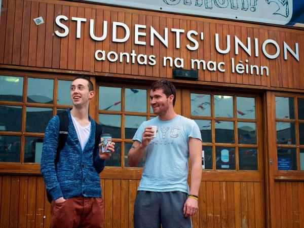 """Chris Kelly, right, used to run an auto repair shop but lost it during the recession. Kelly, 30, is now studying technology management at the University of Limerick. David Watters, a 20-year-old human resources student, wants to move to Dubai. """"The generation that's between 18 and 25, they're leaving because they think there's no future in Ireland,"""" Watters says."""