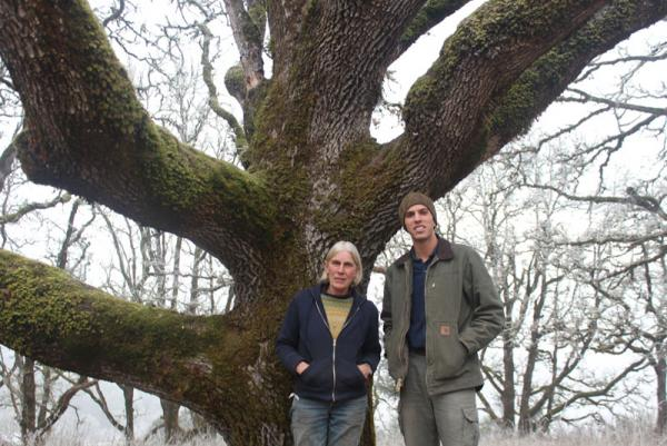 Sarah and Ben Deumling stand beneath one of the many oak trees on their 1,300 acre property northwest of Salem.