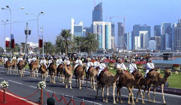 Soldiers on camels take part in a military parade on Qatar's National Day in the capital Doha last Wednesday. The city's rapidly growing skyline is in the background. Despite its small size, Qatar has used its wealth to play an outsized role in regional affairs.