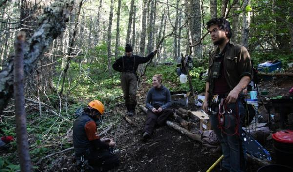Ground camp: Josh Eng, right, prepares to climb up a fir tree with fellow protesters (from left) Brian Garcia, Shannon Wilson and Kate Armstrong. The group is protesting a plan to log at the site.