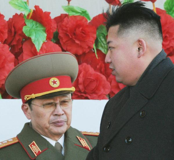Before their split: North Korean leader Kim Jong Un, right, and his uncle, Jang Song Thaek, in February 2012. Earlier this month, Jang was executed.