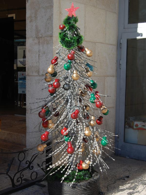 One piece of protest art stands at a gallery just off Manger Square. The tree is made of concertina wire and decorated with used tear gas canisters.