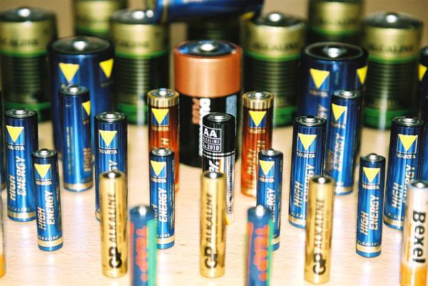 Americans buy and throw away billions of batteries each year. (tomblois/Flickr)