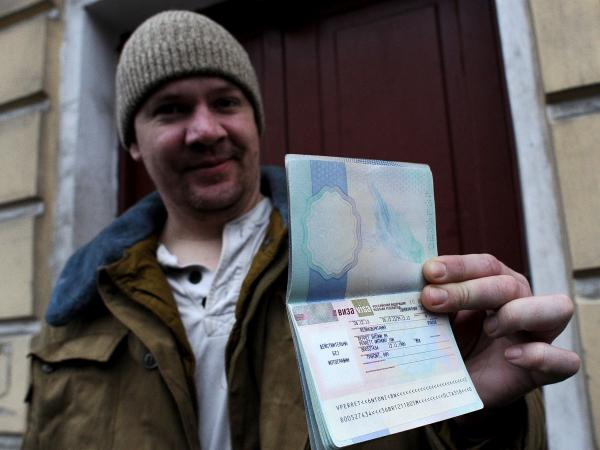 In St. Petersburg on Thursday, Greenpeace International activist Anthony Perrett, a British citizen, showed the Russian transit visa that's now in his passport.